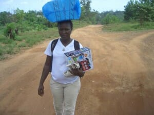 Aminata carrying the radios